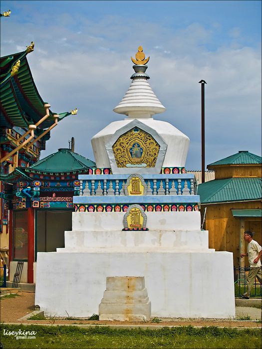 The top of stupa is decorated with a soyombo symbol