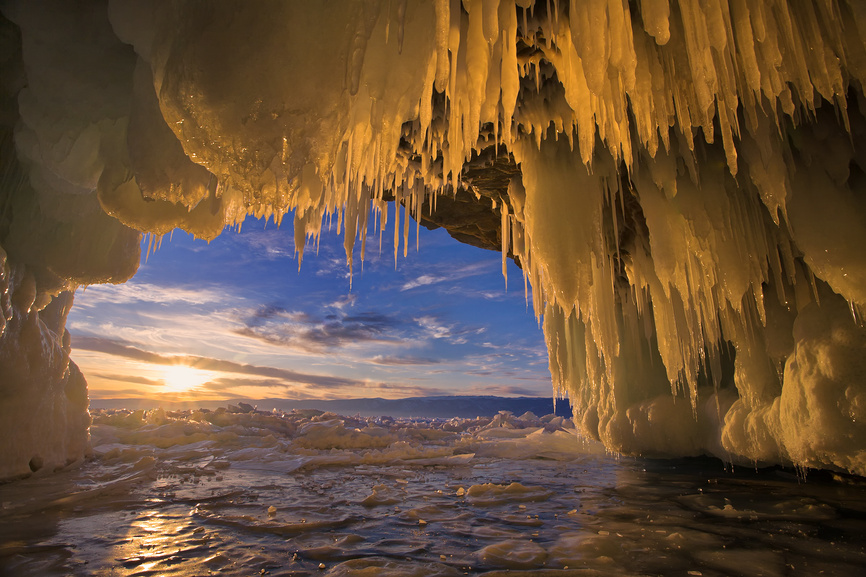 Baikal. Sunset view from the ice grotto on the island of Kharantsy