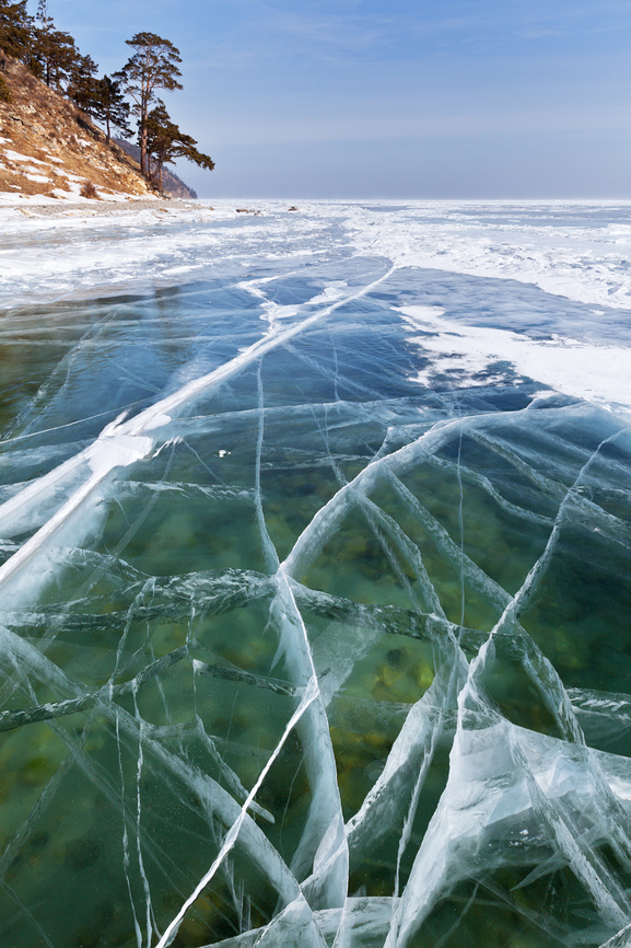 Baikal. Winter landscape with transparent ice near the shore in Goloustnoe